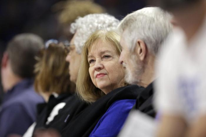 In this Nov. 17, 2019, file photo, St. Louis Mayor Lyda Krewson sits during an NCAA college basketball game between Saint Louis and Seton Hall in St. Louis.