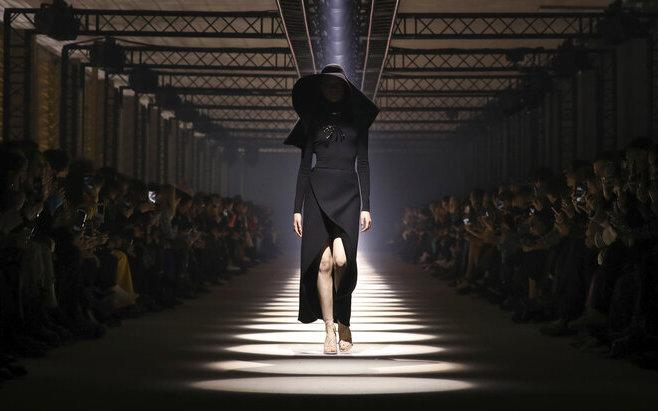 In this March 1, 2020 file photo, a model wears a creation for the Givenchy fashion collection during Women's fashion week Fall/Winter 2020/21 presented in Paris.