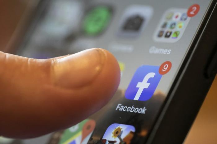 In this Aug. 11, 2019, file photo, an iPhone displays the Facebook app in New Orleans