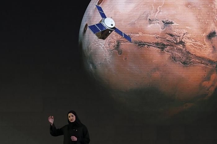 "In this Wednesday, May 6, 2015 file photo, Sarah Amiri, deputy project manager of the United Arab Emirates Mars mission, talks about the project named ""Hope,"" or ""al-Amal"" in Arabic, which is scheduled for launch in 2020, during a ceremony in Dubai, UAE"