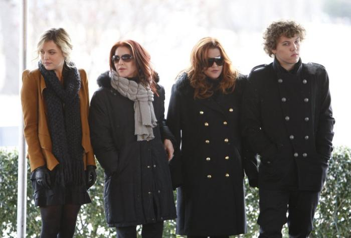 In this Jan. 8, 2010, file photo, Priscilla Presley, second from left, her daughter, Lisa Marie Presley, second from right, and Lisa Marie's children, Riley Keough, left, and Benjamin Keough, right, take part in a ceremony in Memphis, Tenn., commemorating Elvis Presley's 75th birthday