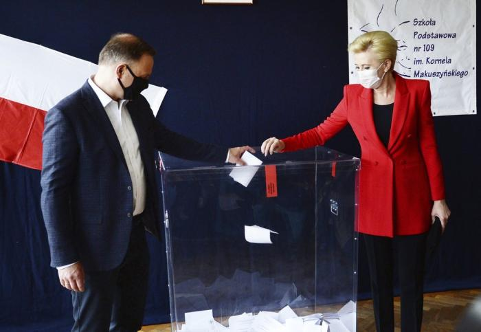 Candidate in Poland's tight presidential election runoff, incumbent President Andrzej Duda and First Lady Agata Kornhauser-Duda cast their ballots at a polling station in their hometown of Krakow, Poland, on Sunday, July 12, 2020.
