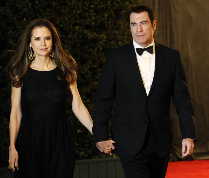 Actress Kelly Preston, left and her husband John Travolta arrive at the Academy of Motion Picture Arts and Sciences' 2011 Governors Awards, in Los Angeles.