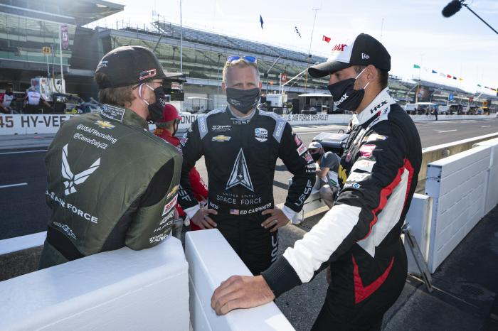 Ed Carpenter, center, talks with Conor Daly, left, and Rinus VeeKay, of the Netherlands, before practice for the Indianapolis 500 auto race at Indianapolis Motor Speedway in Indianapolis, Friday, Aug. 21, 2020.