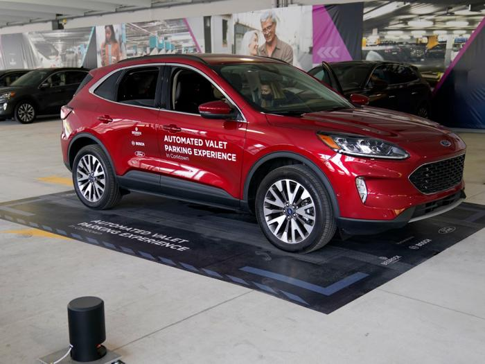A Ford Escape is seen on a starting block before floor sensors help navigate the vehicle to self park, Tuesday, Aug. 25, 2020 in Detroit