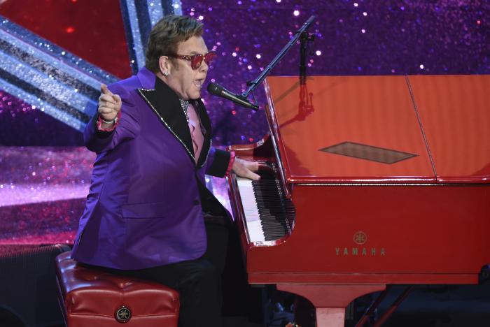 """Elton John performs """"(I'm Gonna) Love Me Again,"""" nominated for the award for best original song, from """"Rocketman"""" at the Oscars in Los Angeles."""