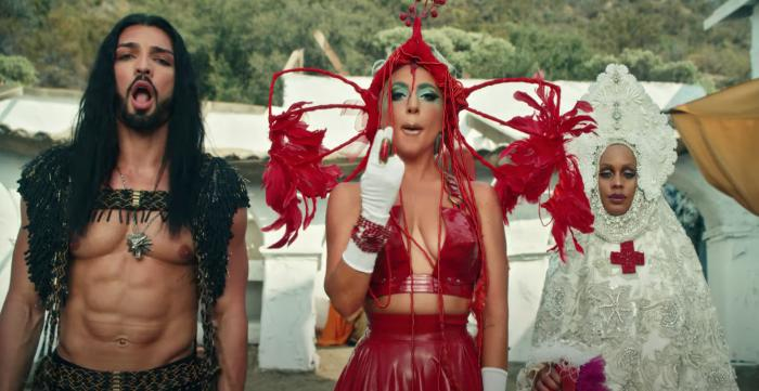"Lady Gaga, center, in her music video for ""911."""