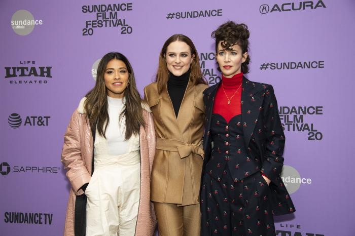 """Actors, from left, Gina Rodriguez and Evan Rachel Wood pose with writer-director Miranda July at the premiere of """"Kajillionaire"""" during the 2020 Sundance Film Festival in Park City, Utah."""