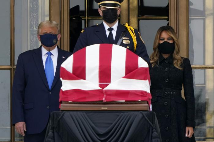 President Donald Trump and first lady Melania Trump pay respects as Justice Ruth Bader Ginsburg lies in repose at the Supreme Court building.