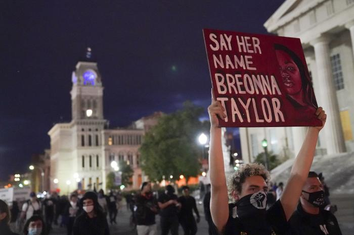 Protesters march, Thursday, Sept. 24, 2020, in Louisville, Ky.