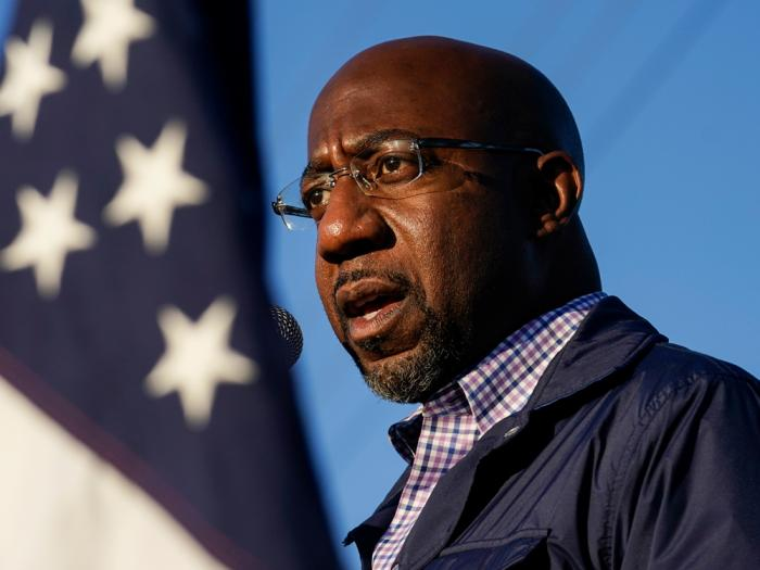 In this Nov. 15, 2020, file photo Raphael Warnock, a Democratic candidate for the U.S. Senate, speaks during a campaign rally in Marietta, Ga.