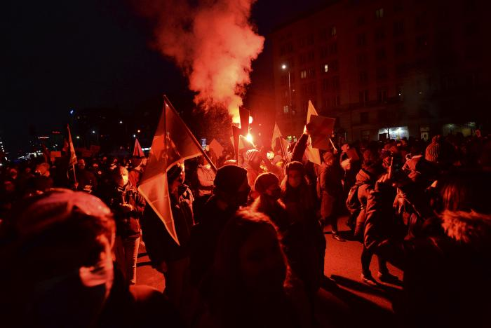 People demonstrate against police violence and an attempted restriction on abortion rights in Warsaw Poland.
