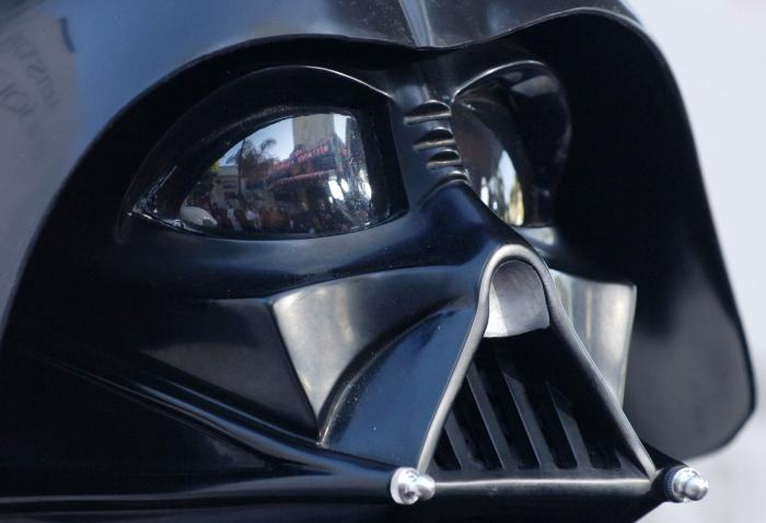 "The premiere of the movie ""Star Wars: Revenge of the Sith"", is reflected in the mask eyeglasses of iconic baddie character Darth Vader."