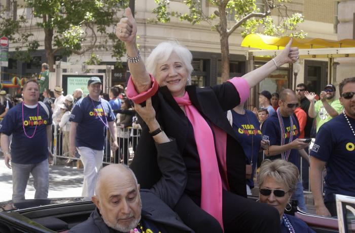 In this June 26, 2011 file photo, Actress Olympia Dukakis, a celebrity Grand Marshall for the 41st annual Gay Pride parade, waves to the crowd while being driven past them in San Francisco.