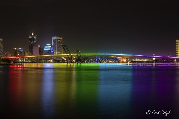 The Acosta Bridge is illuminated with rainbow lighting in honor of Pride Month, Monday, June 7, 2021, in downtown Jacksonville, Fla.