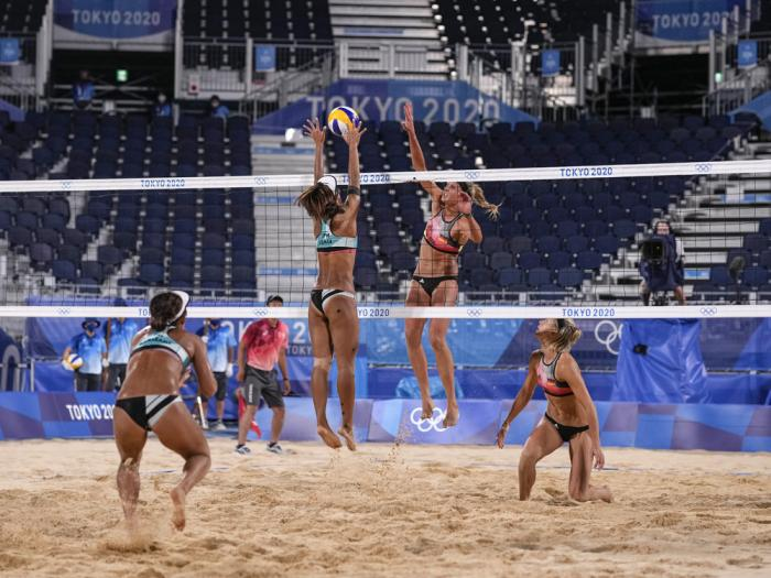 In this July 26, 2021, file photo, Miki Ishii, right, of Japan, attempts to block against Margareta Kozuch, of Germany, during a women's beach volleyball match at the 2020 Summer Olympics in Tokyo, Japan