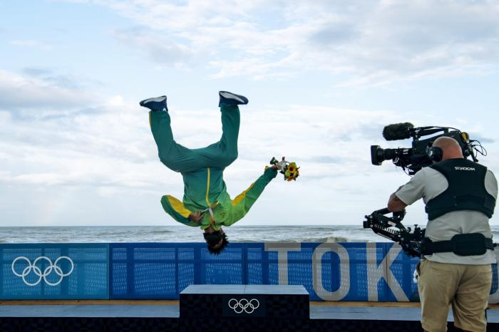 Brazil's Italo Ferreira celebrates after winning the gold medal in the men's surfing competition at the 2020 Summer Olympics, Tuesday, July 27, 2021, at Tsurigasaki beach in Ichinomiya, Japan. (Olivier Morin/Pool Photo via AP)