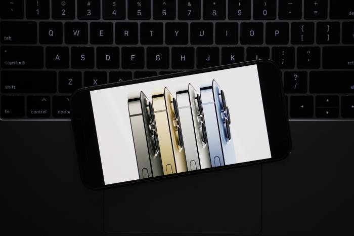 Seen on the screen of a device in La Habra, Calif., the new iPhone 13 Pro smartphones are introduced during a virtual event held to announce new Apple products.